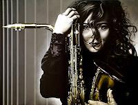 A. Baumann, Frau mit Saxofon